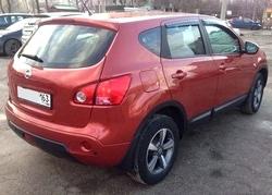 Автомобиль Nissan Qashqai оранжевый